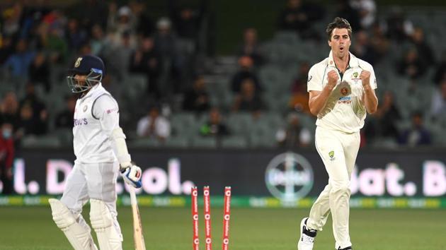 Australian bowler Pat Cummins reacts after dismissing Indian batsman Prithvi Shaw (L) for 4 runs on day 2 of the first test match between Australia and India at Adelaide Oval, Adelaide, Australia, December 18, 2020.(via REUTERS)