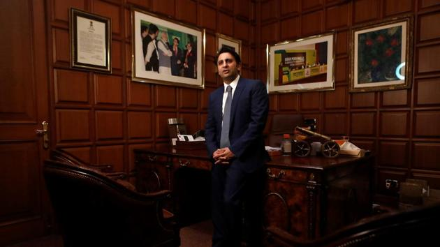 Adar Poonawalla, Chief Executive Officer (CEO) of the Serum Institute of India poses for a picture inside his office at the Serum Institute of India, in Pune.(REUTERS)