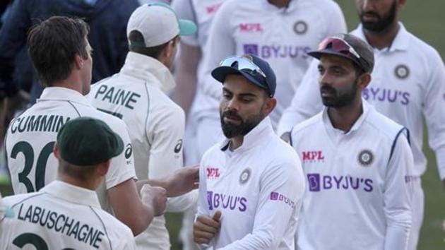 India's Virat Kohli, center, shakes hands with Australian players on the third day of their cricket test match at the Adelaide Oval in Adelaide, Australia, Saturday, Dec. 19, 2020. Australia won the match.(AP)