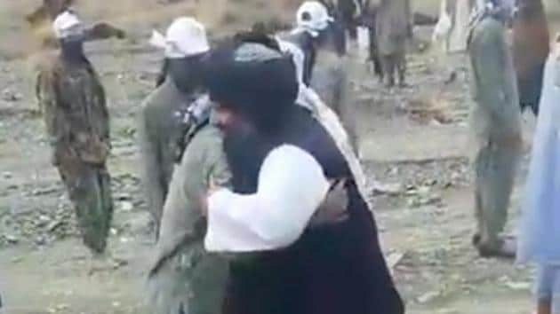 A video shows Mullah Fazal Akhund meeting masked men clad in fatigues at a Taliban training camp at an undisclosed location in Pakistan. The men can be seen embracing him and kissing his hand.(Sourced)