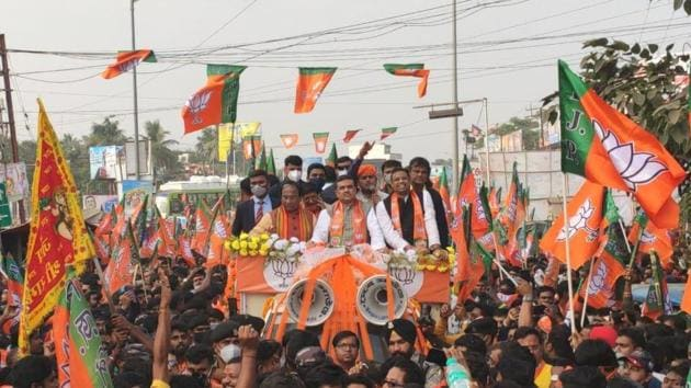Suvendu Adhikari, who was welcomed into the BJP by Union home minister Amit Shah on December 19, was called a traitor at the Trinamool roadshow and rally at Kanthi at his hometown in Bengal's East Midnapore district on Wednesday. (HT Photo)