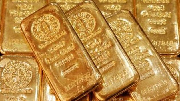 Spot gold edged up 0.3% at USD 1,877.82 an ounce at in New York. Prices are up nearly 24% this year, on course for the biggest annual gain in a decade.(Reuters file photo)