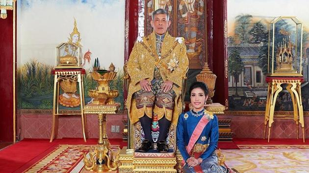 Thailand's King Maha Vajiralongkorn and General Sineenat Wongvajirapakdi, the royal noble consort pose at the Grand Palace in Bangkok, Thailand.(Reuters)