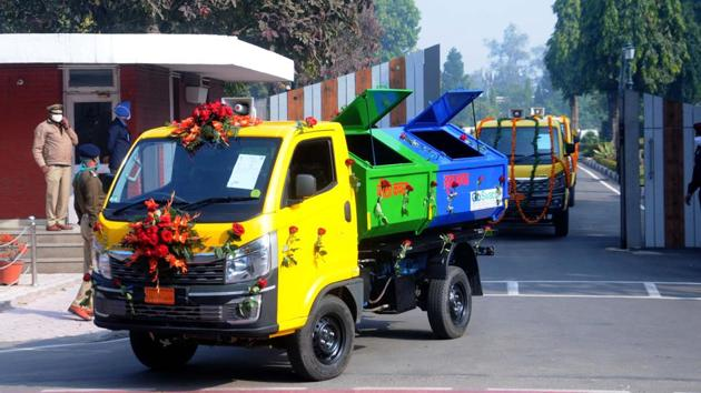 Garbage pickup vehicles on the go for a round of the sectors after being flagged off by UT administrator and Punjab governor VP Singh Badnore at the Punjab Raj Bhawan in Chandigarh earlier this week.(Keshav Singh/HT)
