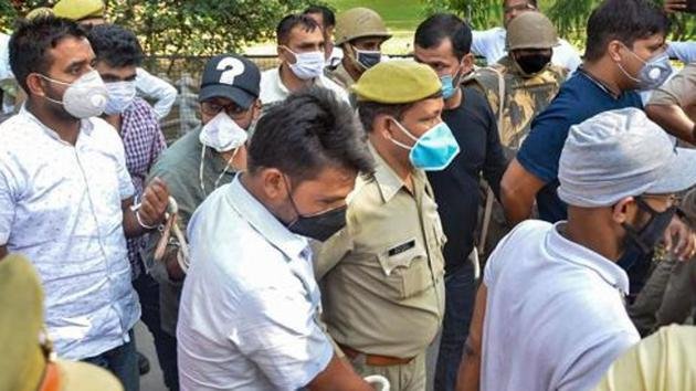 Siddique Kappan and three others, suspected to have links with the Popular Front of India and SIMI, being produced in a Mathura court.(PTI Photo)