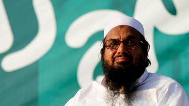 Hafiz Muhammad Saeed, chief of the banned Islamic charity Jamaat-ud-Dawah, looks over the crowd at a protest in Islamabad.(REUTERS)
