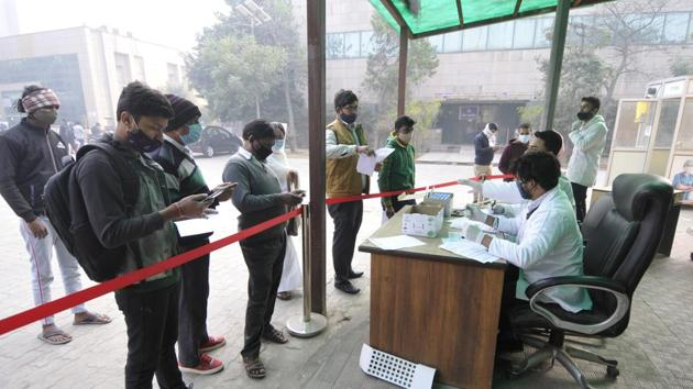 People being registered for coronavirus tests at a hospital in Noida. (Photo by Sunil Ghosh / Hindustan Times)