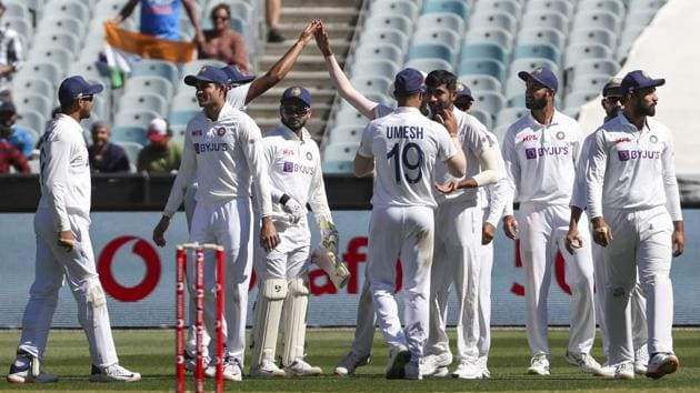 Indian players celebrate the wicket of Australia's Mitchell Starc during play on day one of the Boxing Day cricket test between India and Australia at the Melbourne Cricket Ground, Melbourne, Australia, Saturday, Dec. 26, 2020.(AP)