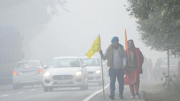 People on their way to Gurudwara Fatehgarh Sahib in Patiala on December 25. The World Meteorological Organization (WMO) has said that various meteorological parameters indicate that La Niña, which began in September, is approaching its peak and may return to neutral conditions only late next summer. Scientists say this could mean a long, harsh winter in north India and could impact the coming monsoon. (Bharat Bhushan / HT Photo)