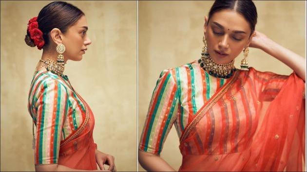 Aditi Rao offers refreshing festive inspo in red organza silk saree(Instagram/sanamratansi/kishandasjewellery)