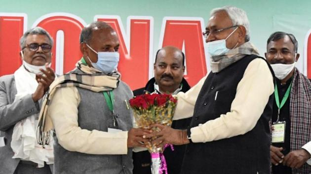 Bihar Chief Minister Nitish Kumar greets newly elected Janata Dal (United) national president RCP Singh during anational executive meeting of the party in Patna on Sunday.(ANI)