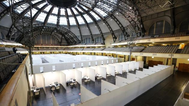 Vaccination booths in the Festhalle auditorium hall at the Frankfurt Messe exhibition grounds in Frankfurt, Germany.(Bloomberg Photo)