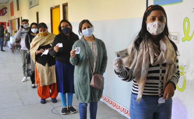 Women queue up at a polling booth at the Government Model Primary School in Sector-12-A, Panchkula, on Sunday.(Keshav Singh/HT)