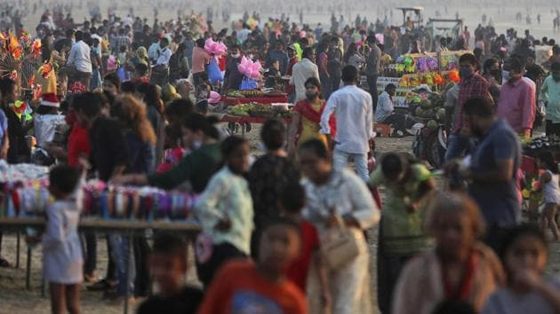 People crowd at a Juhu beach in Mumbai, India, Saturday, Dec. 26, 2020. India's confirmed coronavirus cases have crossed 10 million with new infections dipping to their lowest levels in three months.(AP)