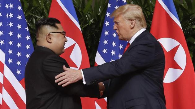 President Donald Trump, right, shakes hands with North Korea leader Kim Jong Un at the Capella resort on Sentosa Island in Singapore.(AP file photo)