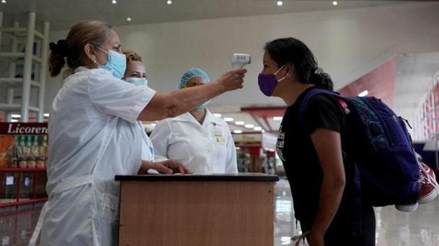 A traveller has her temperature checked at an airport.(Representational photo/REUTERS)