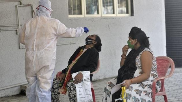Since the woman was asymptomatic, she was asked to be in quarantine for seven days.(Satyabrata Tripathy/HT Photo)