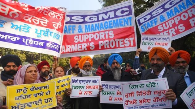 Demonstrators with posters and banners outside Vigyan Bhavan as a delegation representing farmers' unions arrives for talks with the Centre over ongoing protests against new farm laws, in New Delhi on Wednesday.(Amal KS/HT Photo)