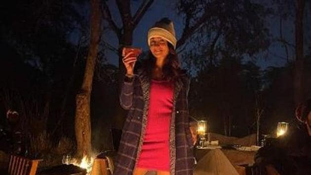 Alia Bhatt poses with a drink in Ranthambore.