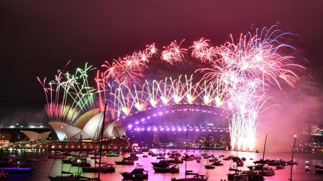 Fireworks explode over the Sydney Opera House and Sydney Harbour Bridge during downsized New Year's Eve celebrations during the COVID-19 pandemic, in Australia.(via REUTERS)