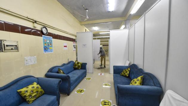 A worker cleans the national capital's first Covid-19 vaccination centre at Srinivaspuri area in New Delhi.(PTI)