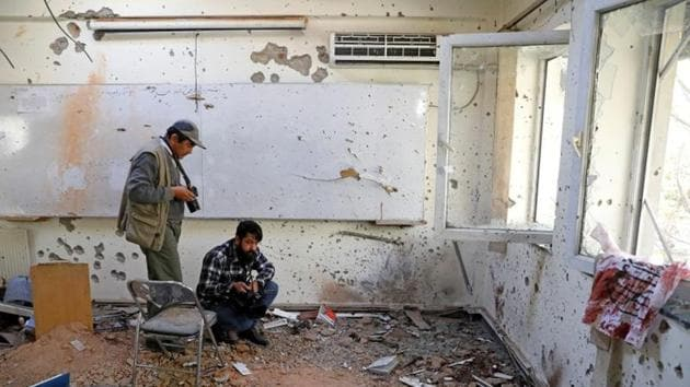 Afghan journalists film inside a class after the attack at the University of Kabul, Afghanistan.(REUTERS)