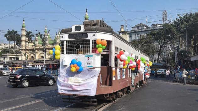 A tram carrying passengers runs on a track to raise awareness against the coronavirus on the New Year's eve at Esplannade Tram depot in Kolkata.(PTI)
