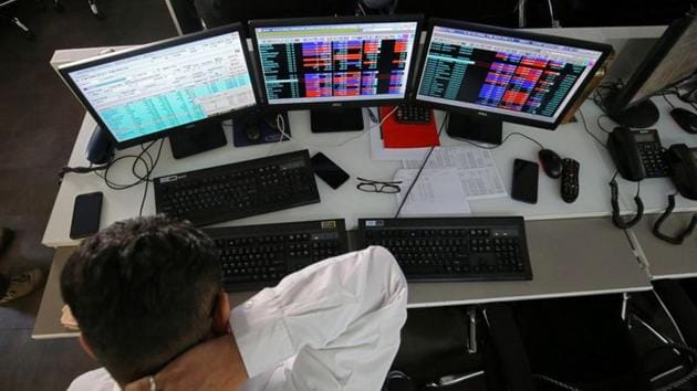 A broker reacts while trading at his computer terminal at a stock brokerage firm in Mumbai, India.(REUTERS)