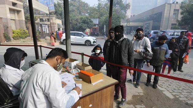 People queue to register for coronavirus tests, at Sector 30 District Hospital, in Noida, India. (Photo by Sunil Ghosh / Hindustan Times)