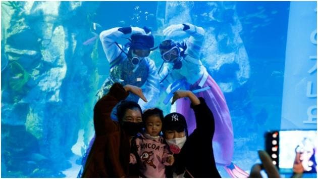 Divers in 'Hanbok' send New Year greetings from underwater at South Korean(Reuters)