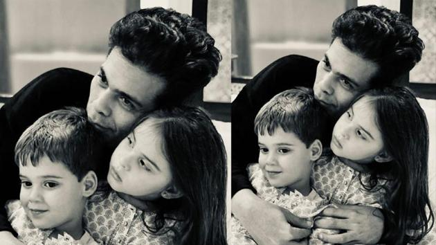 Karan Johar had shared a picture with his kids to wish fans on new year.