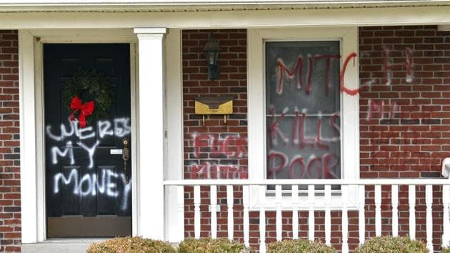 The home of Senate Majority Leader Mitch McConnell is shown as it was vandalized overnight in Louisville, Ky., on Saturday.(AP Photo)