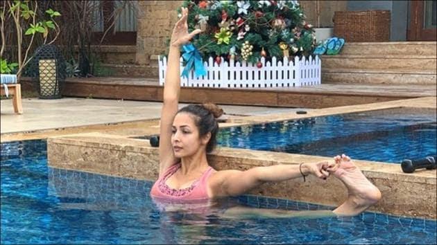 Malaika Arora leaves us in awe of her balance as she nails Yoga move inside pool(Instagram/malaikaaroraofficial)