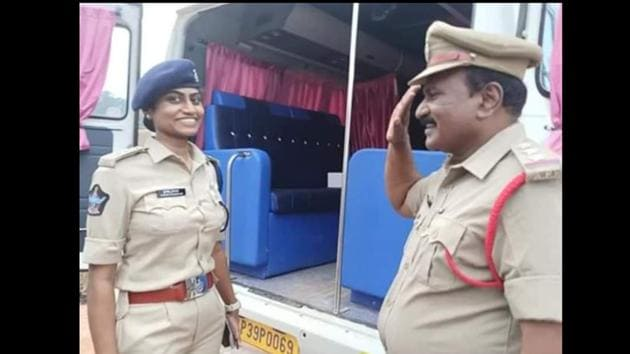 The image shows Shyam Sundar saluting his daughter with a smiling face.(Twitter/@AndhraPradeshPolice)