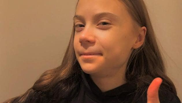 Activist Greta Thunberg gestures in a photo which was posted with a message thanking her supporters for their well wishes for her 18th birthday, in this undated picture taken from social media.(@GRETATHUNBERG via REUTERS)
