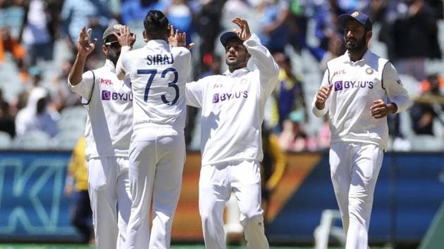 India's MD Siraj, second left, is congratulated by teammates after getting the wicket of Australia's Cameron Green during play on day four of the second cricket test between India and Australia at the Melbourne Cricket Ground.(AP)