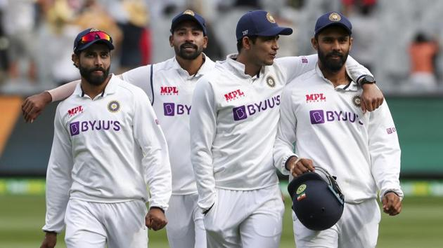 Indian players walk from the field at the close of play on day three of the second cricket test between India and Australia at the Melbourne Cricket Ground, Melbourne.(AP)