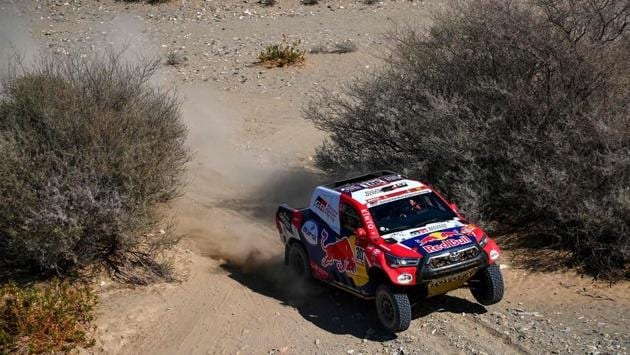 """Toyota's Qatari driver Nasser Al-Attiyah and his co-driver Mathieu Baumel of France compete during Stage 1 of the 2021 Dakar Rally between Jeddah and Bisha in Saudi Arabia on January 3. The Dakar Rally kicks off on January 3 in Saudi Arabia, the second time the world's most gruelling event in motorsport's calendar has been held in the kingdom amid continued accusations of """"sportswashing"""". (Franck Fife / AFP)"""