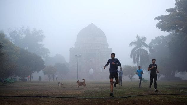 People jogging at Lodhi Garden in New Delhi on January 4. According to the health ministry, 9,946,867 people have recovered until now with 19,557 patients of Covid-19 cured or discharged across the country in the previous 24 hour period. (Adnan Abidi / REUTERS)