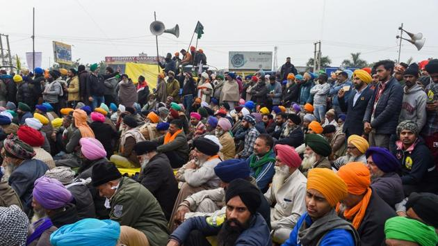 Farmers during their protest against the new farm laws, at Singhu border in New Delhi.(PTI)