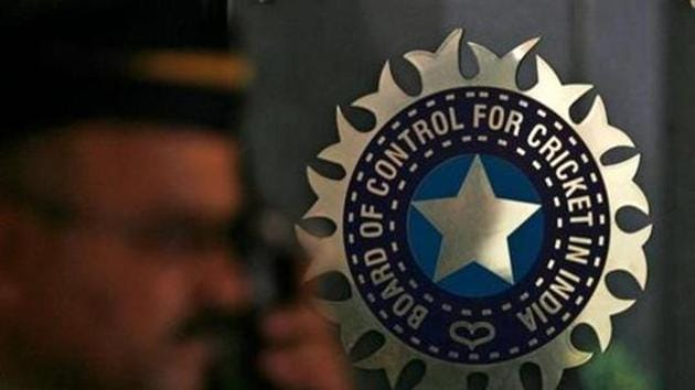 A policeman walks past a logo of the Board of Control for Cricket in India (BCCI)(REUTERS)
