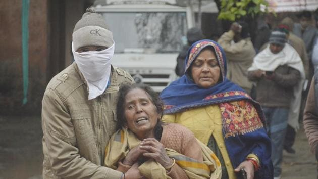 The relatives of a person injured in the collapse of a roof at a crematorium in Muradnagar, seen at MMG district hospital in Ghaziabad, India.(Photo by Sakib Ali /Hindustan Times)