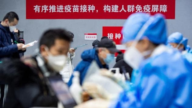 People submit forms to receive the coronavirus disease (Covid-19) vaccine at a makeshift vaccination site in Beijing's Chaoyang district, China January 3, 2021.(REUTERS)