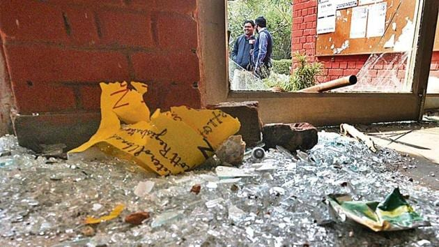 Shards of glass near a gate of the Sabarmati hostel at Jawaharlal Nehru University (JNU) after a mob attacked students, teachers and damaged property on January 5 last year.(Vipin Kumar/HT archive)