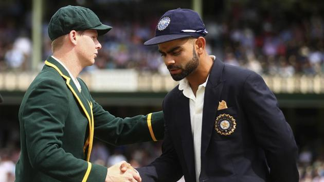 Steve Smith of Australia shakes hands with Virat Kohli of India.(Cricket Australia via Getty Imag)