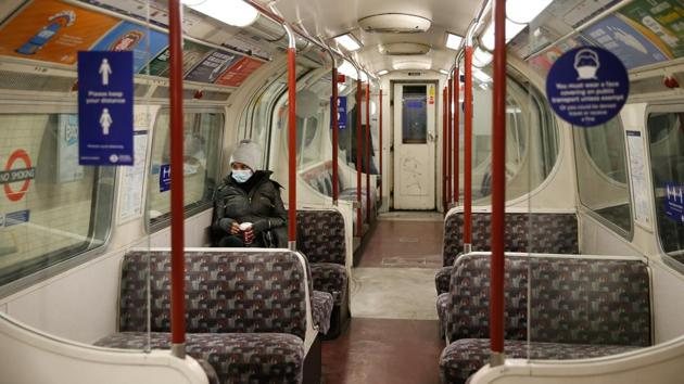 Commuters ride on a London Underground train on the Bakerloo Line on January 5. Britain's economy suffered a historic crash of nearly 20% in the April-June period of 2020 as swathes of business were shuttered by the first lockdown. (Hollie Adams / Bloomberg)