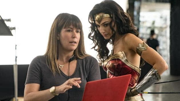 This image released by Warner Bros. Entertainment shows director Patty Jenkins, left, with actress Gal Gadot on the set of Wonder Woman 1984.(AP)