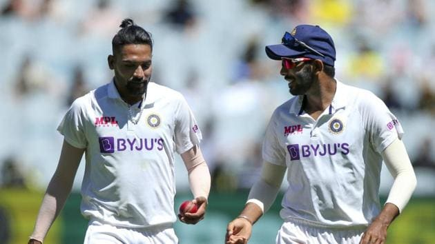 Melbourne : India's MD Siraj, left, and Jasprit Bumrah chat during play on day one of the Boxing Day cricket test between India and Australia at the Melbourne Cricket Ground.(AP)