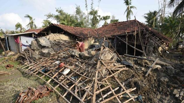 A woman salvages her belongings from her house damaged due to cyclone Amphan, at Kakdwip in the Sunderbans, South 24 Parganas district, West Bengal on May 22, 2020.(HT Archive)