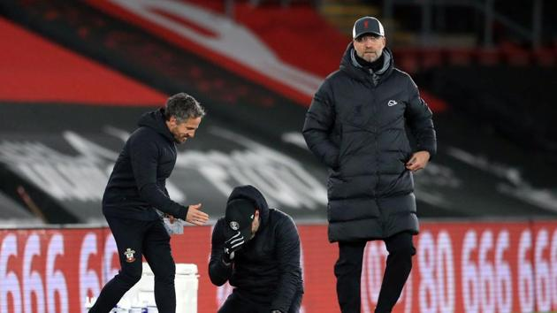 Southampton manager Ralph Hasenhuttl celebrates after the match as Liverpool manager Juergen Klopp looks dejected.(Pool via REUTERS)